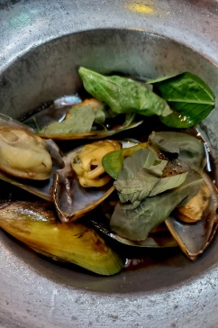 Mussels in a garlic basil sauce.